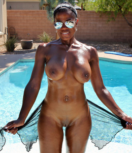Titted Black milf in the pool, she..
