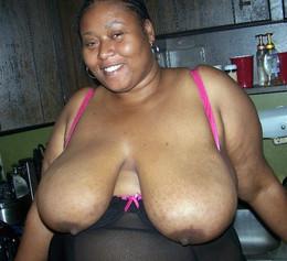Black mature BBW exposing her huge..