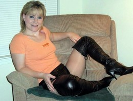 Beautiful housewife dressed high boots..