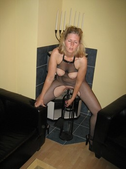 Very seductive housewife in fishnets..