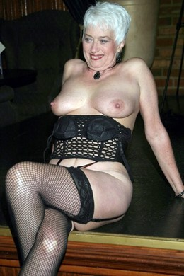 White haired mature in stockings tries..