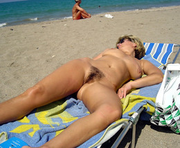 Naked old milf spreads her legs on the..